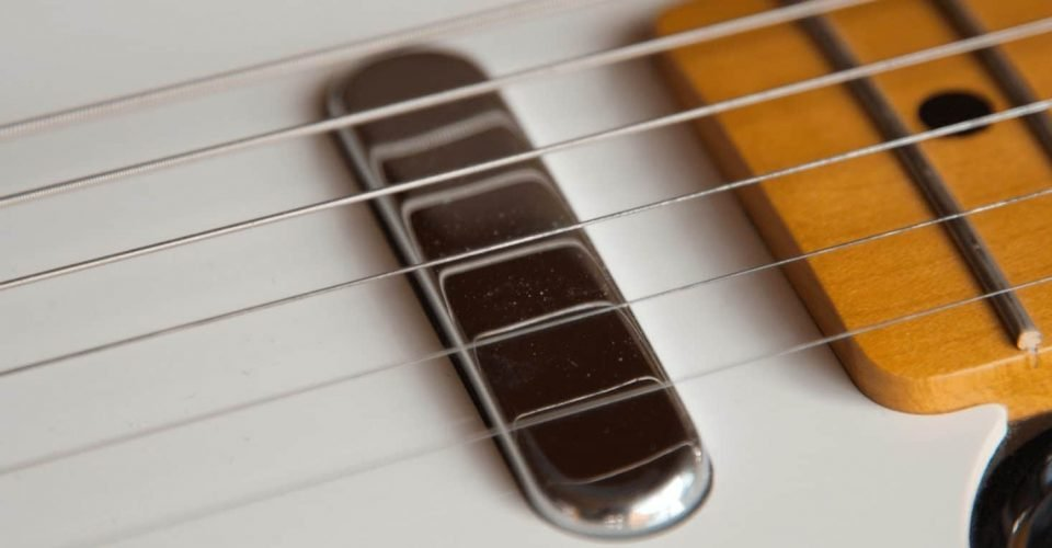 How To Change Guitar Strings The Right Way